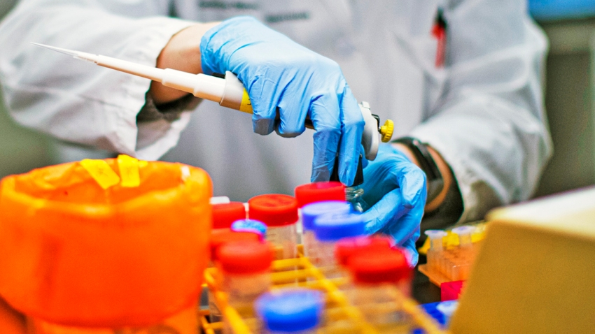 In this file photo, a researcher works in a lab that is developing testing for the COVID-19 coronavirus at Hackensack Meridian Health Center for Discovery and Innovation on February 28, 2020 in Nutley, New Jersey.