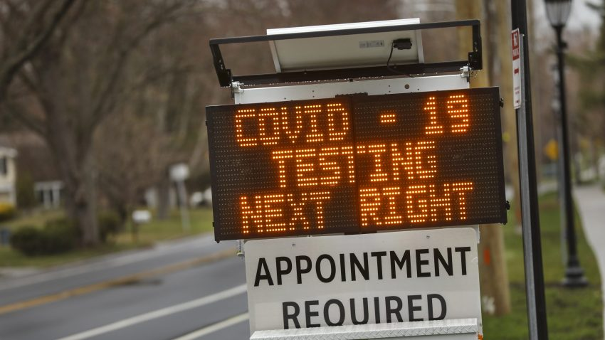 A digital sign directs patients to the drive-thru coronavirus test site