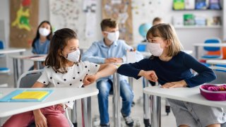 Children with face mask back at school