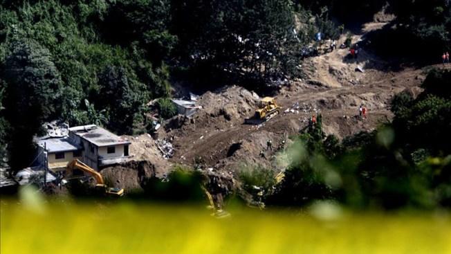 Suben a 253 los muertos por alud en Guatemala